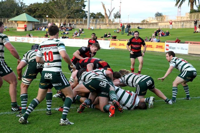 The Rats rearguard holds firm against a rare Red & Black attack - Photo: Clay Cross