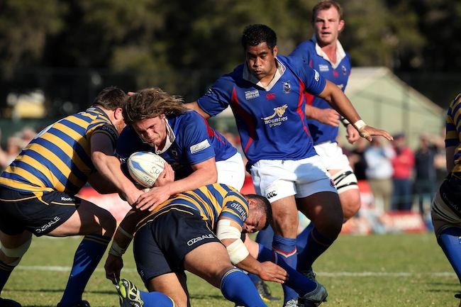 Jordy Reid piles into the Uni defence, watched by Leafa in support, in the 2013 Shute Shield Qualifying Final - Photo: Paul Seiser/SPA Images