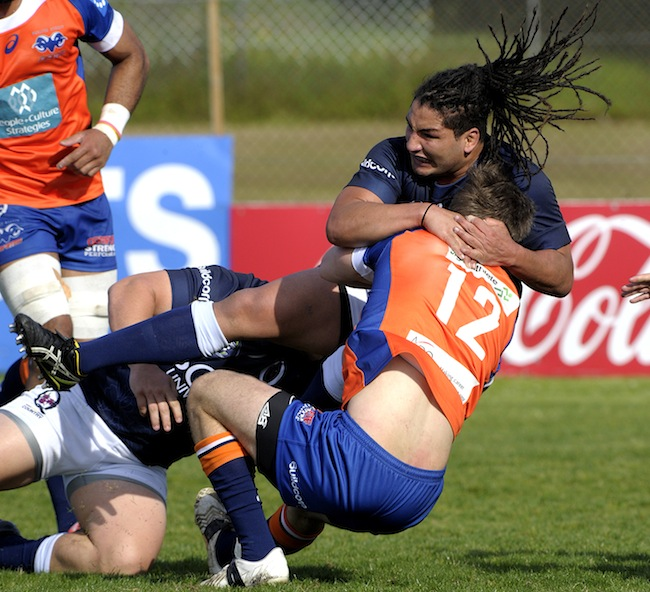 Saia Fainga'a wraps up Rams centre Michael Macdougall - Photo: J.B Photography